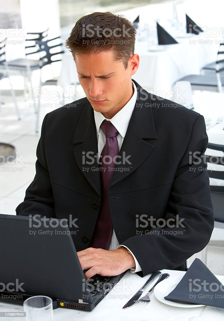 Businessman at an airport restaurent royalty-free stock photo