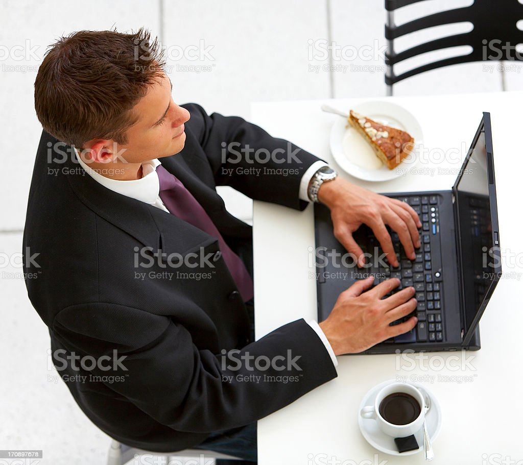 Businessman at an airport restaurent (overhead view) royalty-free stock photo