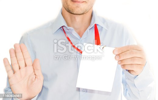 Businessman at an exhibition or conference showing a blank security identity name card