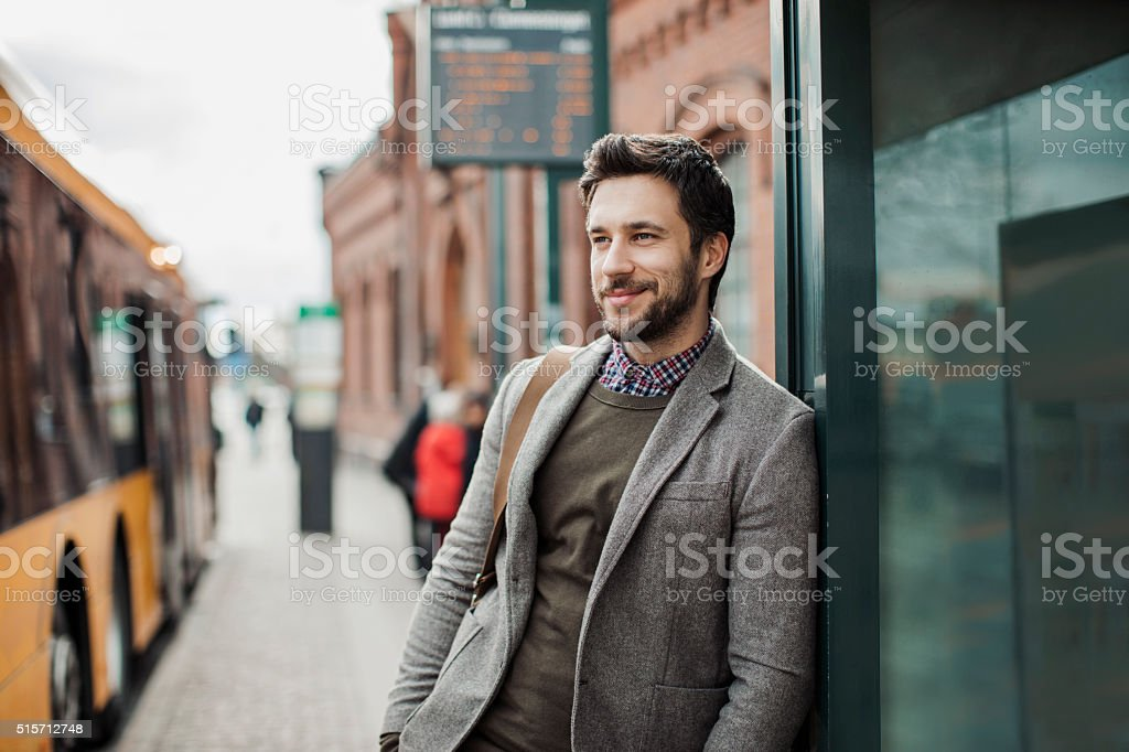 Businessman at bus station stock photo