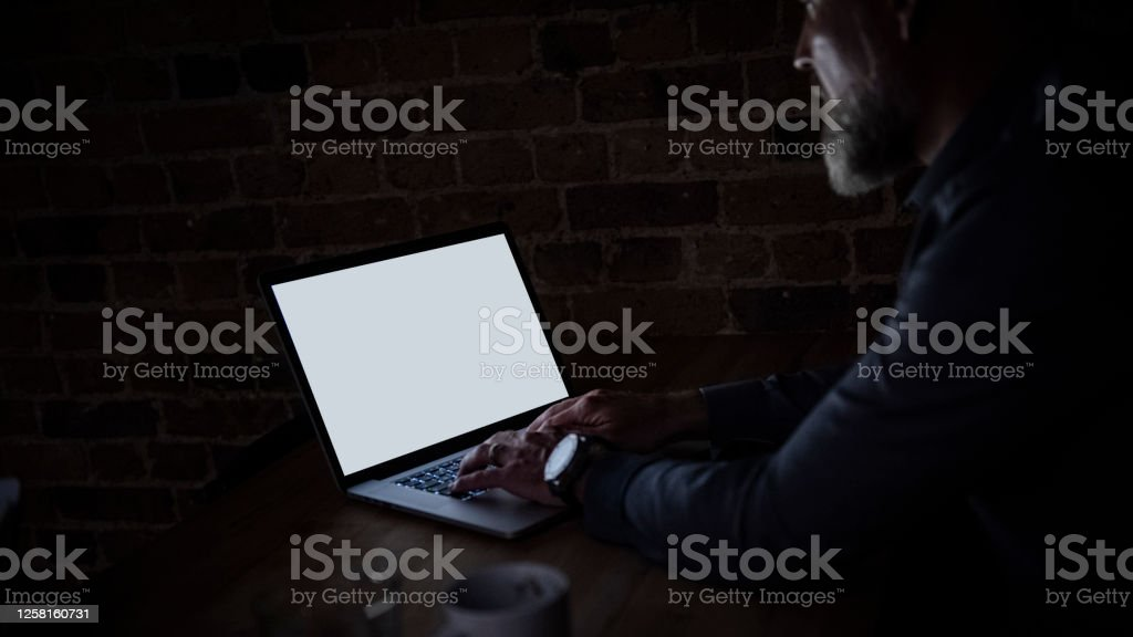 Businessman at laptop with light reflection Businessman at laptop with light reflection 40-49 Years Stock Photo