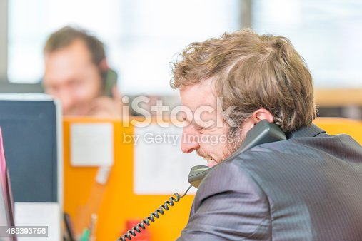 513583458 istock photo Businessman at office on the phone 465393756
