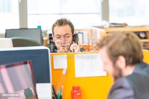 513583458 istock photo Businessman at office on the phone 486939448