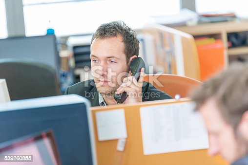 513583458 istock photo Businessman at office on the phone 539260855