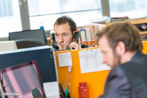 513583458 istock photo Businessman at office on the phone 639014538