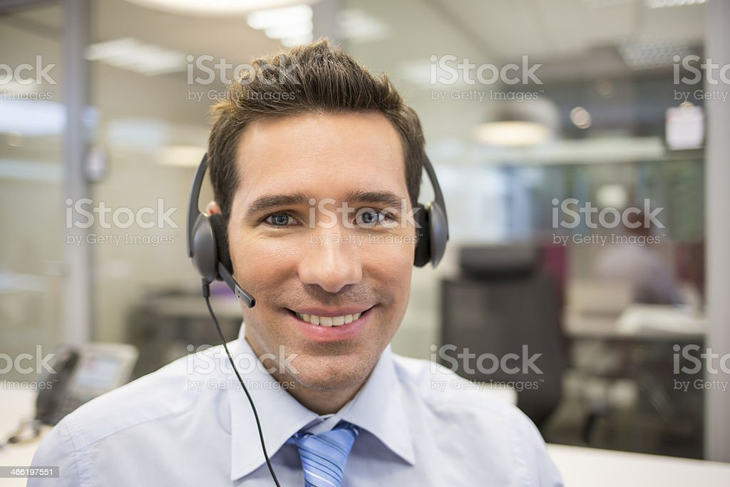 Businessman at office on the phone with headset royalty-free stock photo