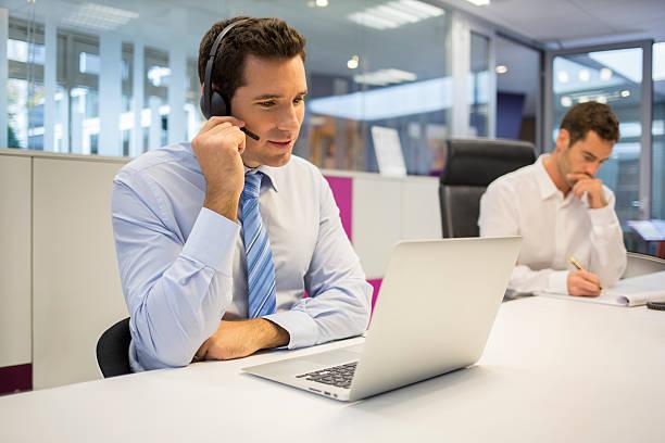 businessman at office on the phone with headset, skype - video call bildbanksfoton och bilder