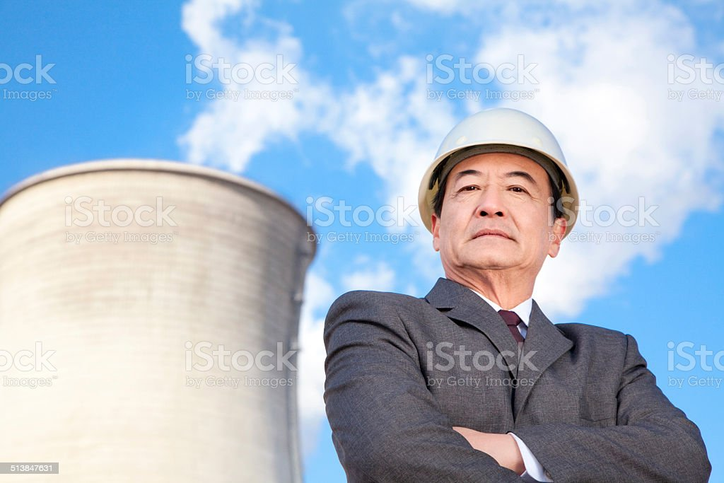 Businessman at power plant stock photo