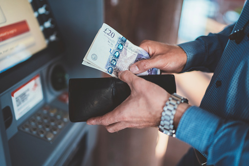 Businessman At The Atm Withdrawing Money Stock Photo - Download Image Now