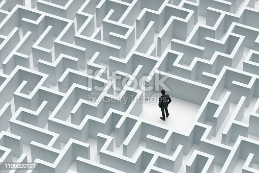 Solution concept with a Businessman at the center of labyrinth, Digitally Generated Image.