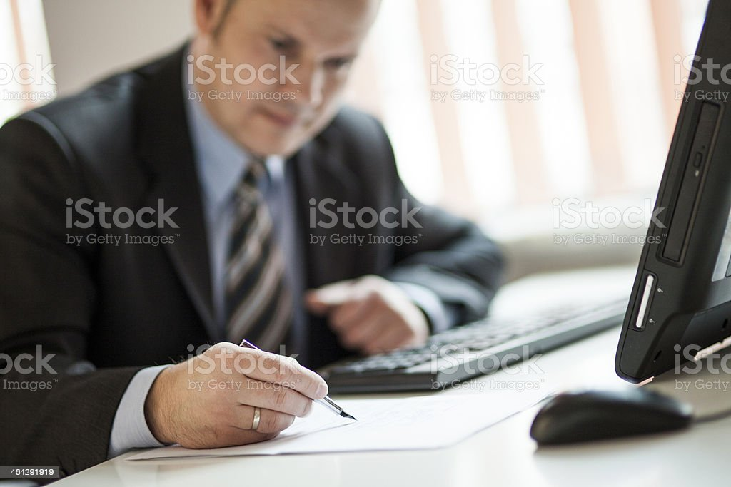 Businessman at the desk in office royalty-free stock photo