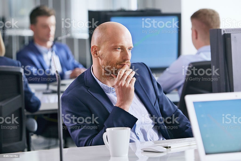 Businessman at the office. Focused on work stock photo
