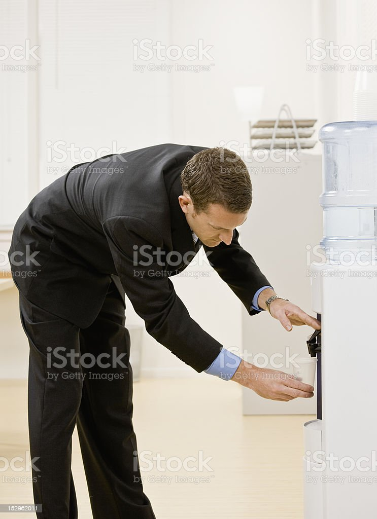 Businessman at Water Cooler stock photo