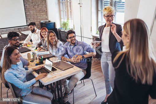istock Businessman At Whiteboard Giving Presentation In Boardroom 946611074