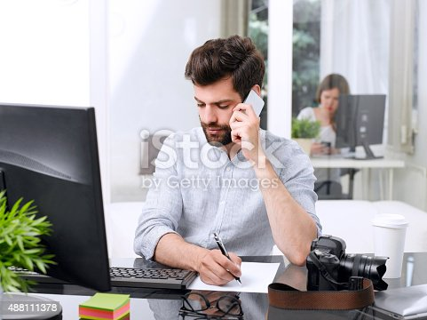 istock Businessman at work 488111378