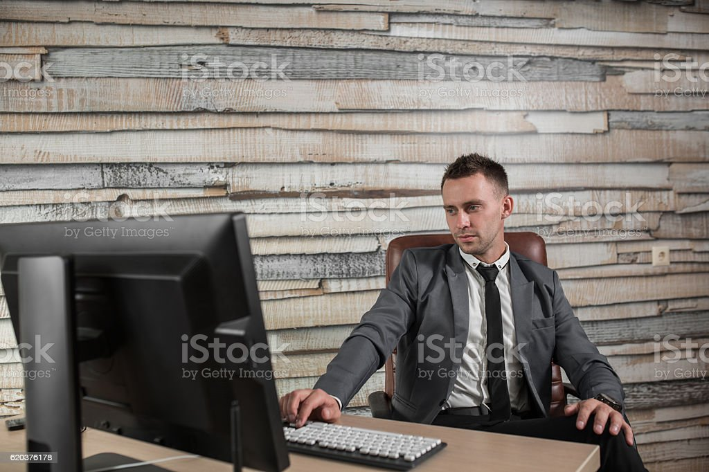 businessman at workplace in office sitting in the leather chair. zbiór zdjęć royalty-free