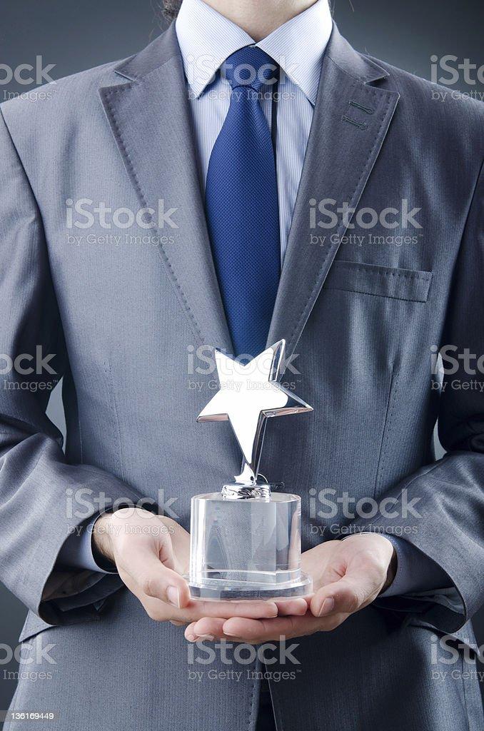 Businessman awarded with star award stock photo