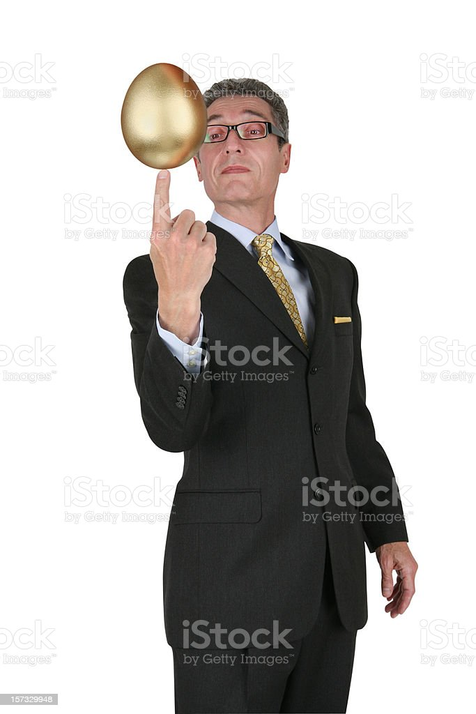 Businessman Balancing Nest Egg with Clipping Path royalty-free stock photo