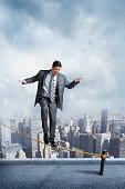 Businessman Balancing On A Tightrope