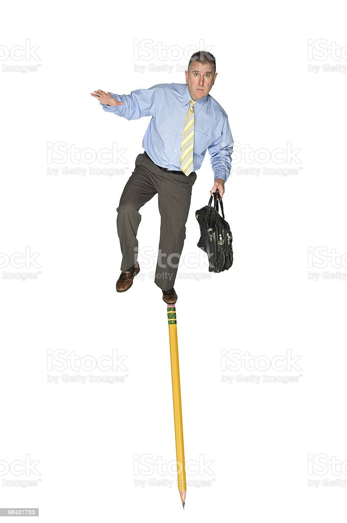 Businessman balancing on pencil royalty-free stock photo