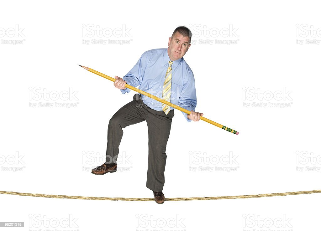 businessman balancing on tightrope royalty-free stock photo