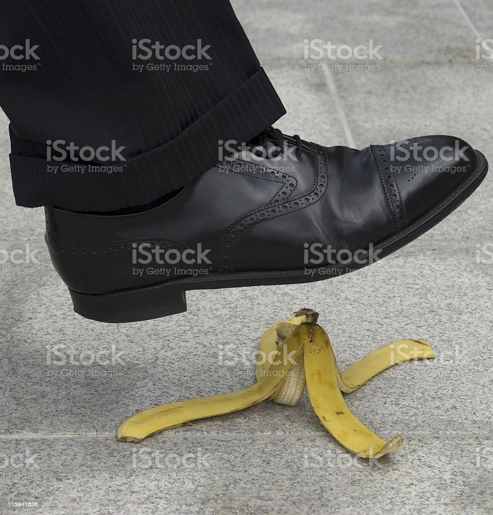 Businessman banana accident royalty-free stock photo
