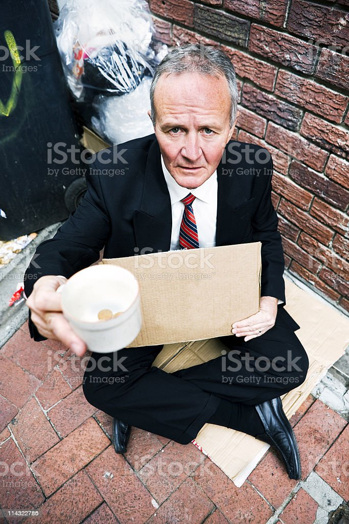 Businessman begging royalty-free stock photo