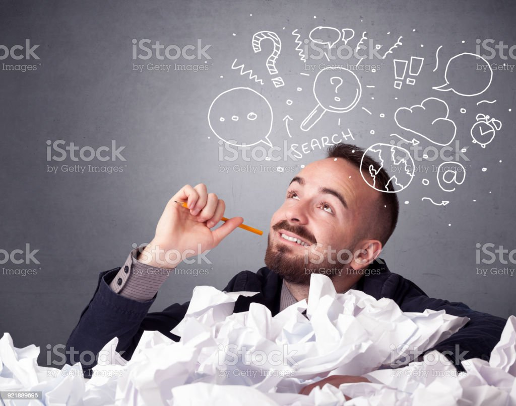 Businessman behind crumpled paper stock photo