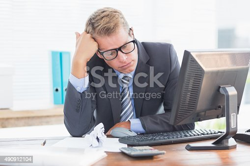 690496350istockphoto Businessman being depressed by accounting 490912104