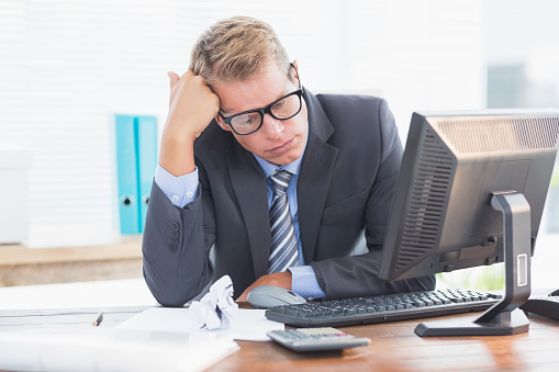690496350 istock photo Businessman being depressed by accounting 490912104