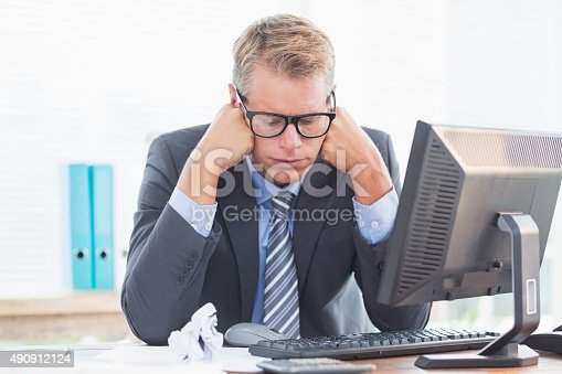 690496350istockphoto Businessman being depressed by accounting 490912124