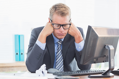 690496350 istock photo Businessman being depressed by accounting 490912124