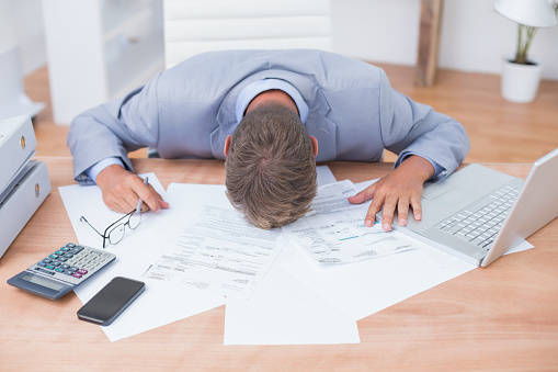 690496350 istock photo Businessman being depressed by accounting 690496350