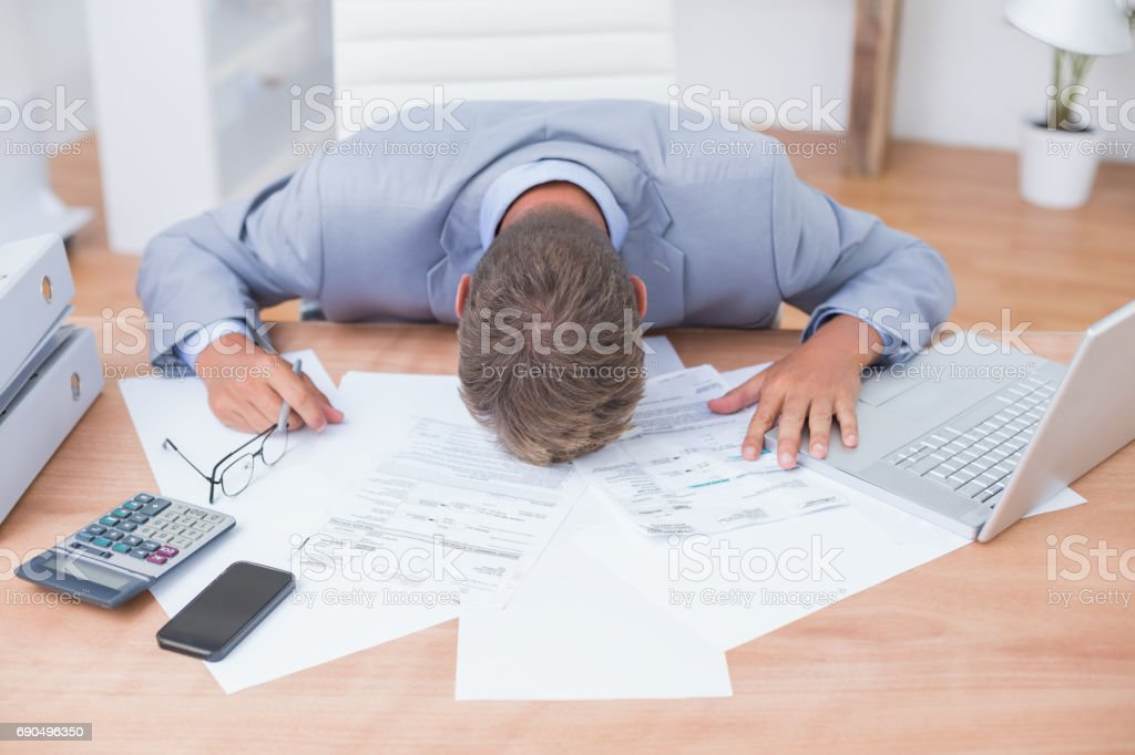 Businessman being depressed by accounting - foto de stock