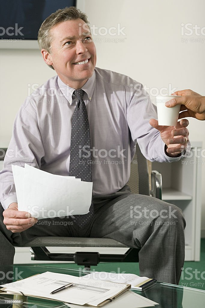 Businessman being handed a drink foto de stock royalty-free