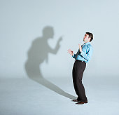 istock Businessman being scolded by his shadow 77931895