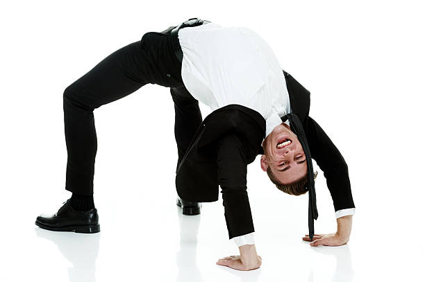 Businessman bending backwards Businessman bending backwardshttp://www.twodozendesign.info/i/1.png bending over backwards stock pictures, royalty-free photos & images