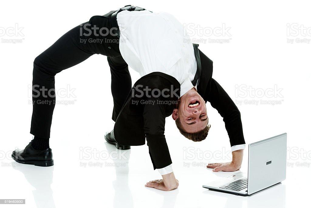 Businessman bending over backwards stock photo