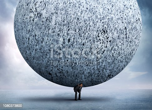 A tiny businessman bends over as he attempts to support a huge stone sphere that sits on his back.