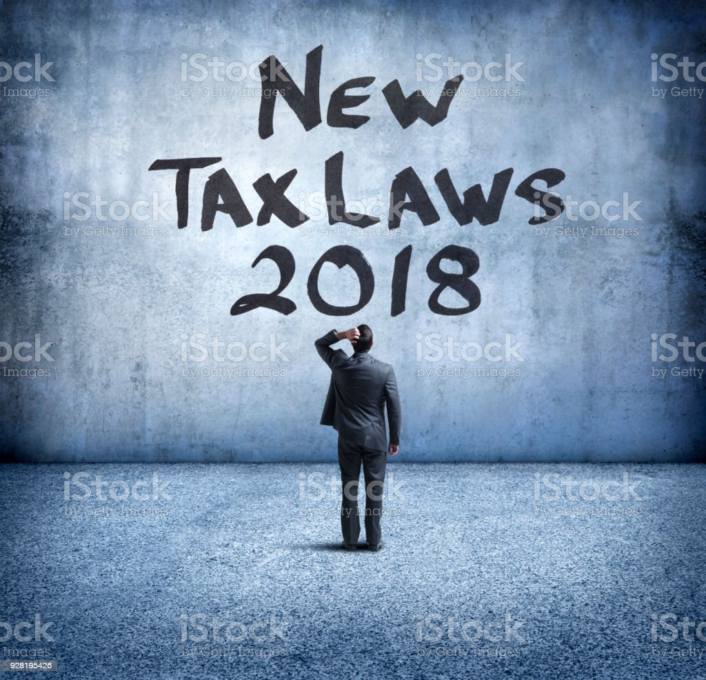 Businessman Bewildered By New 2018 Tax Laws stock photo