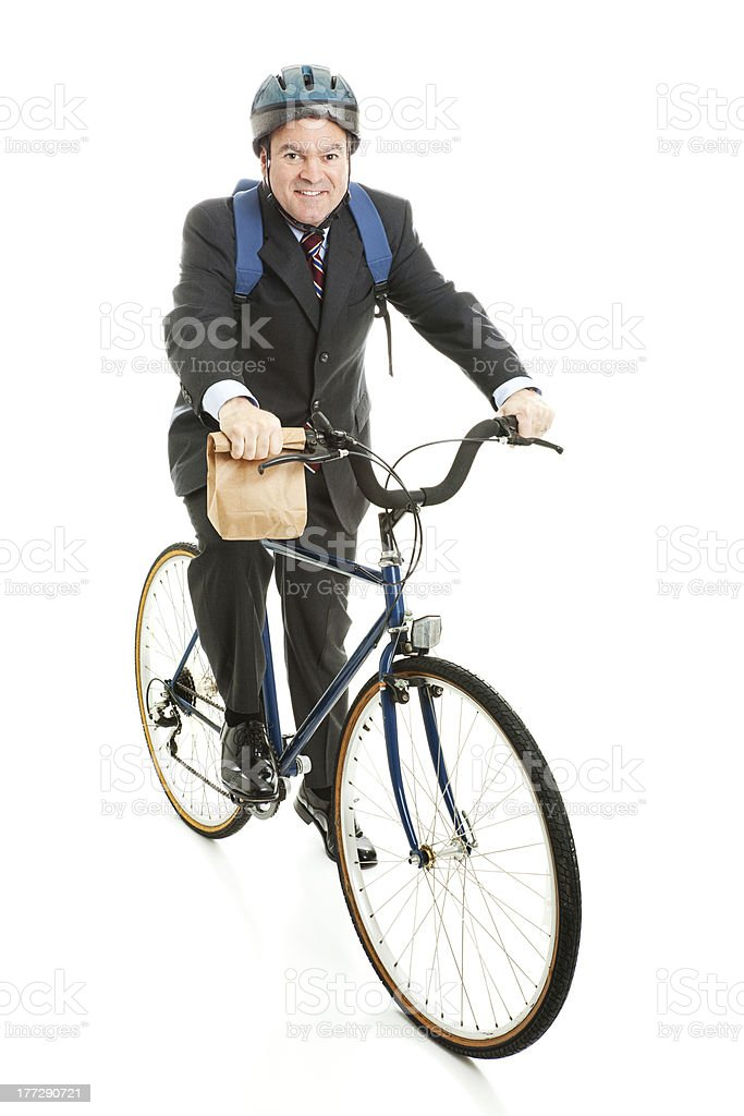 Businessman Bicycles to Work royalty-free stock photo
