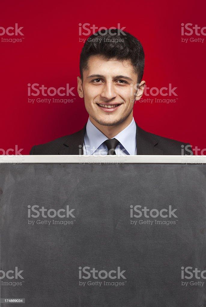 Businessman - Blank Blackboard royalty-free stock photo