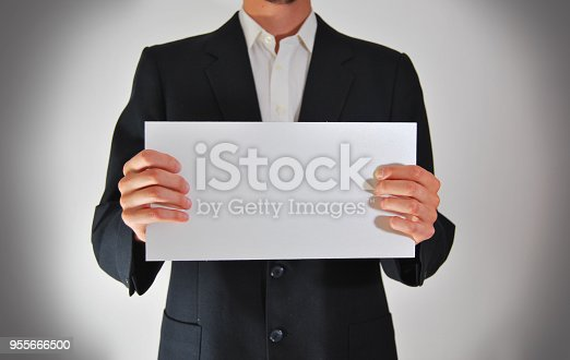 istock Businessman Blank Page 955666500