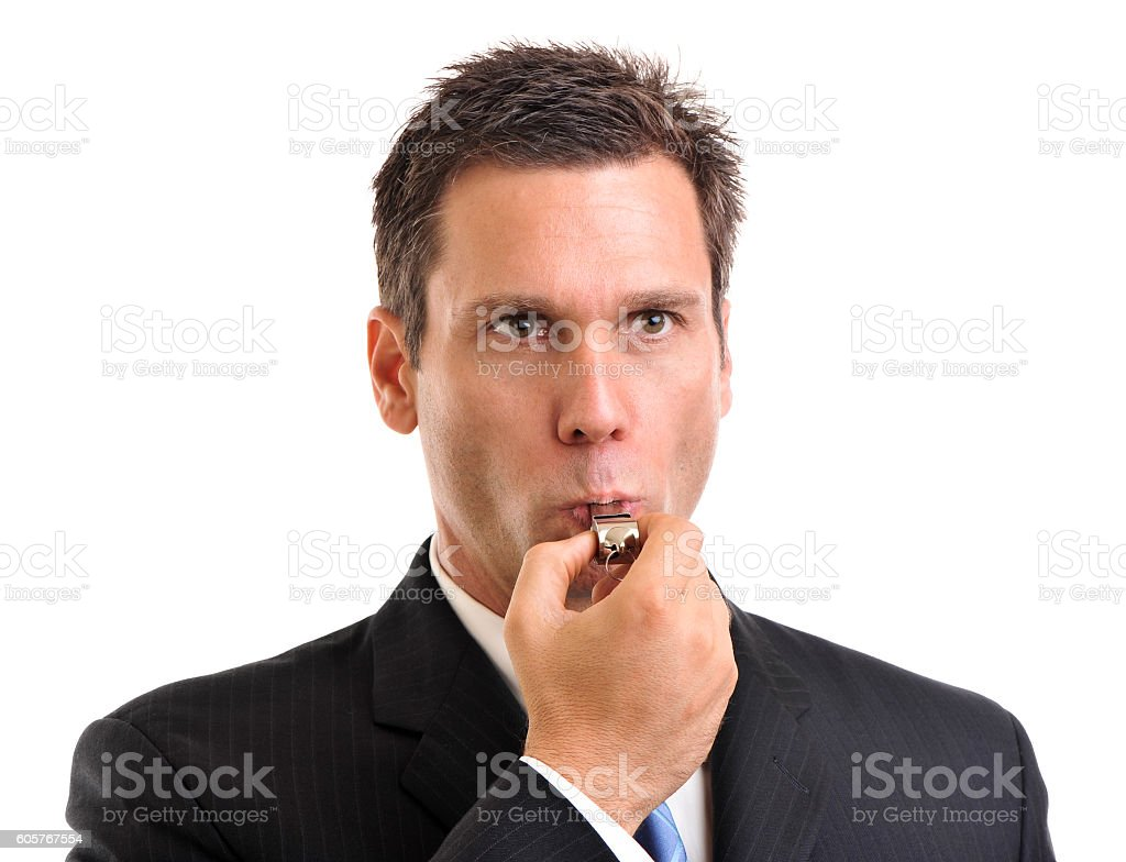 Businessman blowing whistle on white stock photo