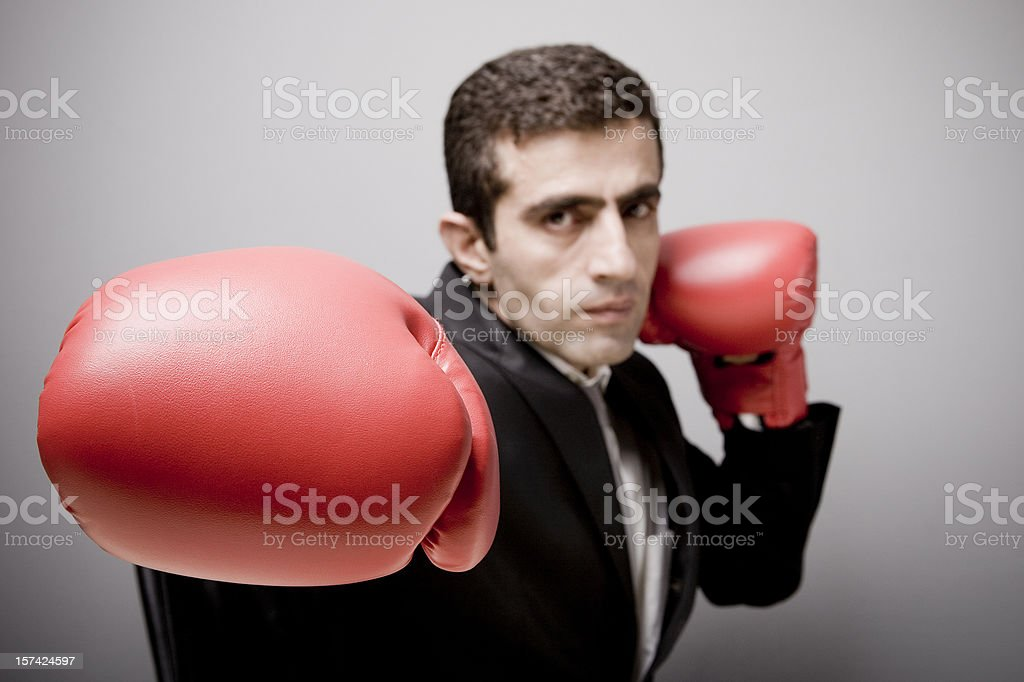 Businessman boxing royalty-free stock photo