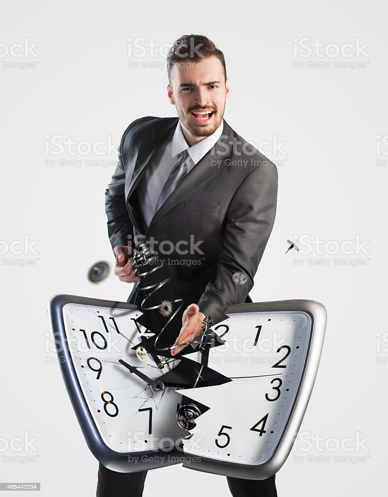 Businessman breaking a clock stock photo