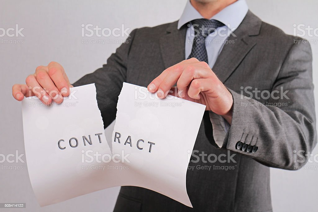 Businessman breaking contract close up. Termination of Contract stock photo