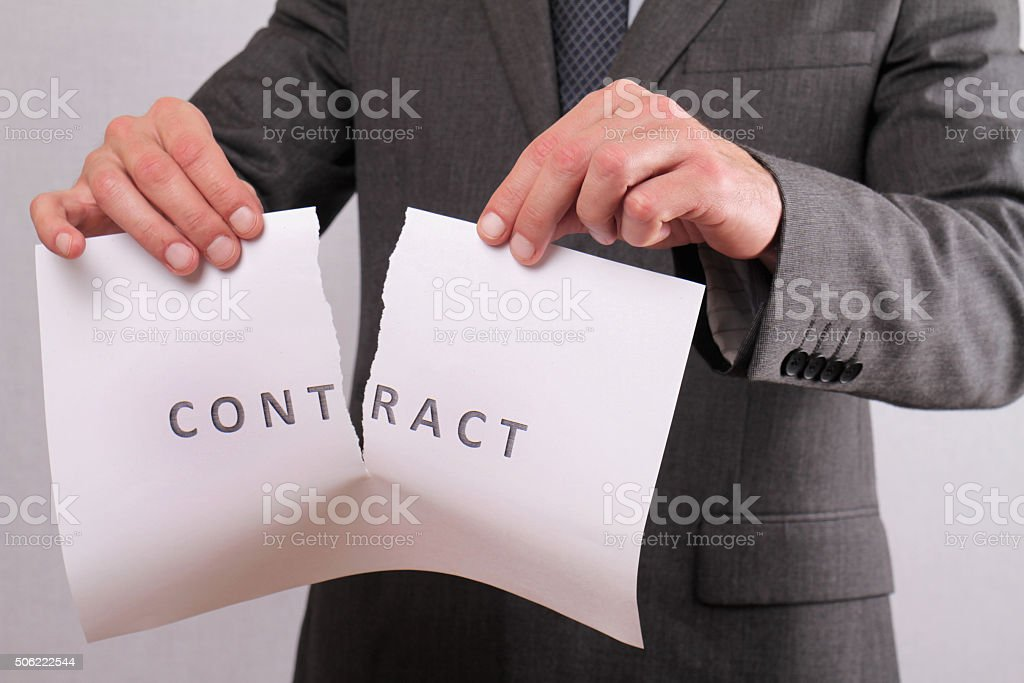 Businessman breaking contract. Termination of Contract stock photo