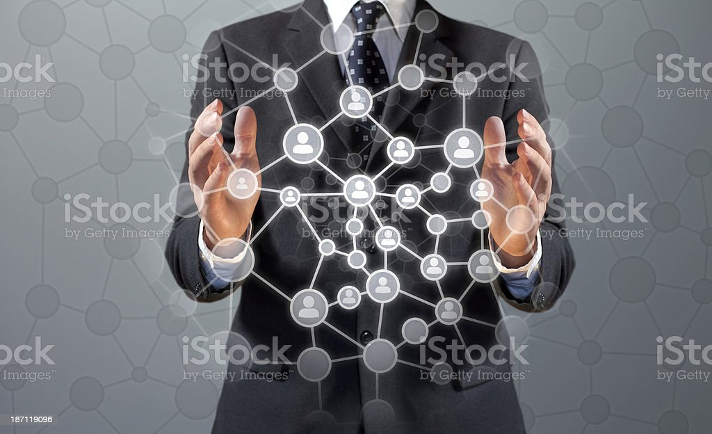 Businessman building a social connection network in the air stock photo