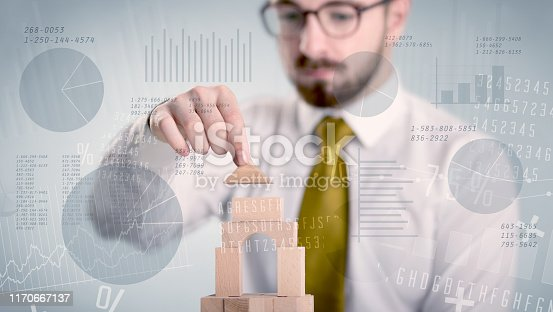 452598975 istock photo Businessman building a tower 1170667137